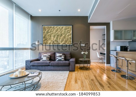 living room with big window and brown wall interior