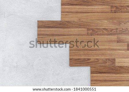 Wooden flooring installation and renovation, with base cement floor Royalty-Free Stock Photo #1841000551