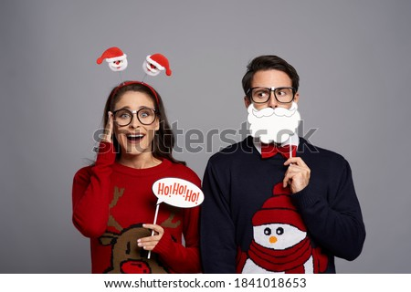 Portrait of couple with funny photo booth gadgets Royalty-Free Stock Photo #1841018653