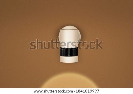 Modern Picture wall lamp on dark yellow background