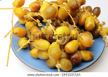 cluster of dates stock images in HD and millions of other royalty-free Date palm fresh ripe yellow fruits (Phoenix Dactylifera) on the clusters in organic fruit.
