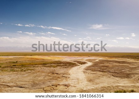 Wide deserted land with curve path. Royalty-Free Stock Photo #1841066314