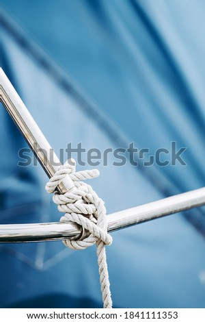 Ropes on a boat - Sailor's knot Royalty-Free Stock Photo #1841111353