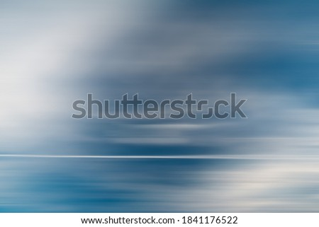 motion blur abstracted background  with blue and white colors