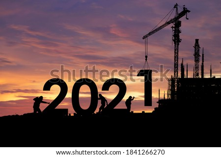 Silhouette staff works as a team to prepare to welcome the new year 2021 #1841266270