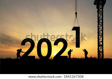 Silhouette staff works as a team to prepare to welcome the new year 2021 #1841267308
