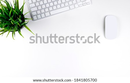 Office desk with copy space. Digital devices wireless keyboard and mouse on office table. Top view Royalty-Free Stock Photo #1841805700