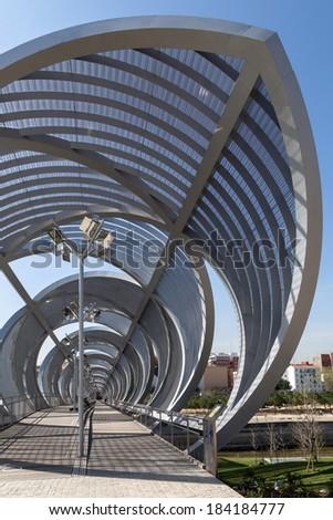 Interior view of the bridge Perrault in Rio Madrid, Spain. Metal bridge progresses in a spiral on pedestrians #184184777