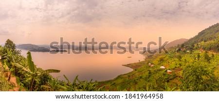 Panoramic crater lake view at sunset in the crater lake region in Uganda near Kibale.