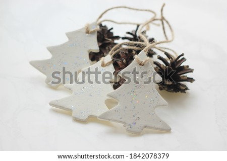 christmas tree ornaments, wall hanging, christmas gift, tree hugger decor, handmade for air dry clay, heart hanging, home decor, creativity present, scandy decoration, selective focus Royalty-Free Stock Photo #1842078379