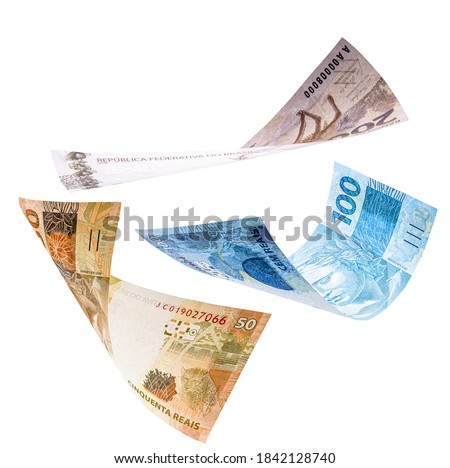 two hundred, one hundred and fifty reais notes in fall, isolated white background. Concept of big loss, inflation and devaluation Royalty-Free Stock Photo #1842128740