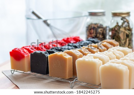 Cut Handmade Soap - Making Handmade Soap Inside the Soap Shop. Cut handmade soap on a table. Royalty-Free Stock Photo #1842245275