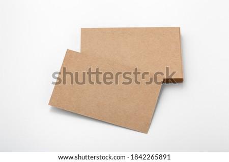 Business card mockup, eco kraft paper on white background