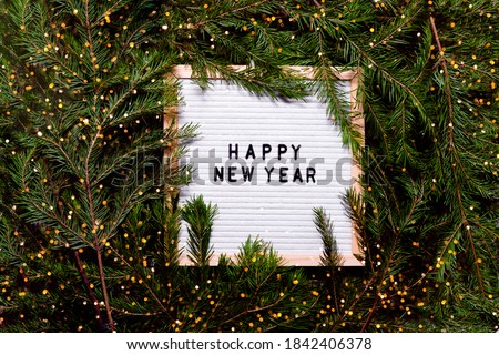 Letter board new year and christmas concept. Top horizontal view copyspace christmas decorations and fur tree. #1842406378