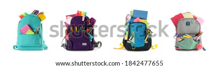 Set of backpacks with bright school stationery on white background, banner design Royalty-Free Stock Photo #1842477655