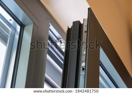 Aluminum window detail. Metal door frame open closeup view. Energy efficient, safety profile, blur background Royalty-Free Stock Photo #1842481750