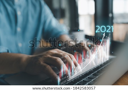 2021 business finance technology and investment concept. Stock Market Investments Funds and Digital Assets. businessman analysing forex trading graph financial data. Business finance background. Royalty-Free Stock Photo #1842583057