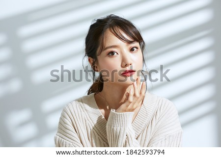 Beauty portrait of young Asian women on light and shadow background Royalty-Free Stock Photo #1842593794