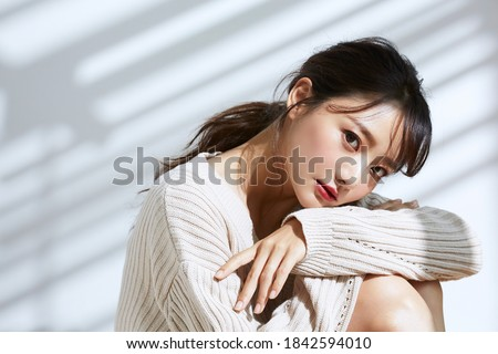 Beauty portrait of young Asian women on light and shadow background Royalty-Free Stock Photo #1842594010