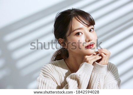 Beauty portrait of young Asian women on light and shadow background Royalty-Free Stock Photo #1842594028