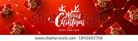 Merry Christmas & Happy New Year Promotion Poster or banner with red gift box and LED String lights for Retail,Shopping or Christmas Promotion in red and black style. #1842603706