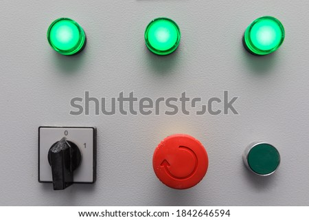 Emergency stop button and other electronic buttons in manufacturing facility Royalty-Free Stock Photo #1842646594