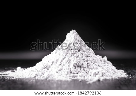 Powdered dolomite. It is a mineral with a clay-like texture and is rich in calcium and magnesium. Derived from limestone rocks, in powders it is used in beauty treatments Royalty-Free Stock Photo #1842792106