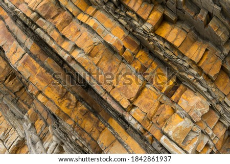 Sandstone rock formations on Sandymouth beach in North Cornwall Royalty-Free Stock Photo #1842861937