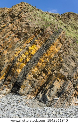 Sandstone rock formations on Sandymouth beach in North Cornwall Royalty-Free Stock Photo #1842861940