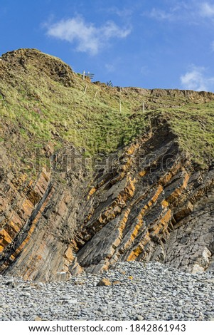 Sandstone rock formations on Sandymouth beach in North Cornwall Royalty-Free Stock Photo #1842861943