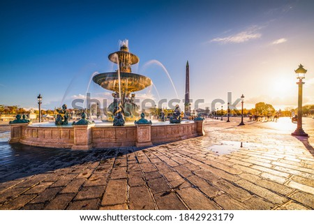 The Place de la Concorde, one of the major public squares in Paris, France and the north fountain, devoted to the rivers at golden hour. Royalty-Free Stock Photo #1842923179