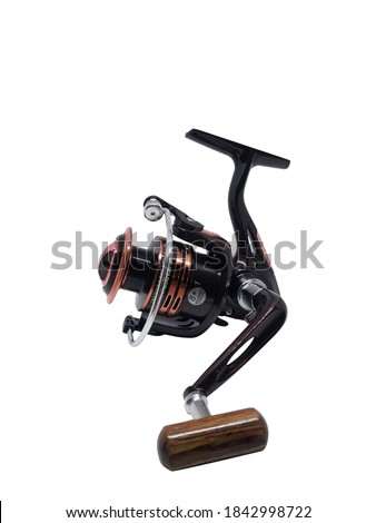 Fishing Reel Isolated on White. Fishing Rod with Aluminum Body & Spool. Black Ruby Metalic Fishing Gear.Fish Supplies and Equipment. Royalty-Free Stock Photo #1842998722