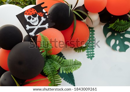 Children's photo zone with a lot of balloons. Decorations for a Birthday party. Concept of children's birthday party in a pirate style. Photozone for a pirate party, birthday party.