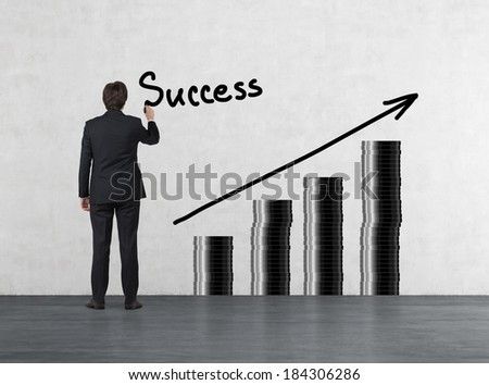 Businessman drawing a graph about success #184306286