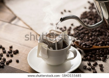 pouring hot water to coffee drip bag Royalty-Free Stock Photo #1843155685