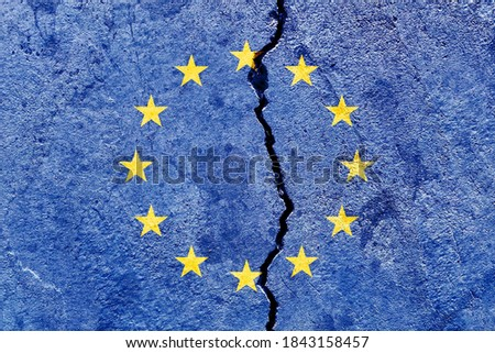 Broken EU (European Union) flag icon isolated on weathered cracked concrete wall background, abstract Europe political relationship divided conflicts concept pattern texture wallpaper Royalty-Free Stock Photo #1843158457
