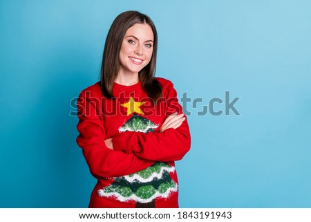 Photo of positive girl in christmas tree decor jumper pullover x-ma stheme party outfit cross hands isolated over blue pastel color background