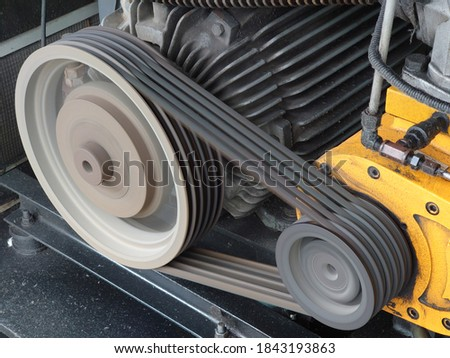Motor running with a belt to drive a screw Royalty-Free Stock Photo #1843193863