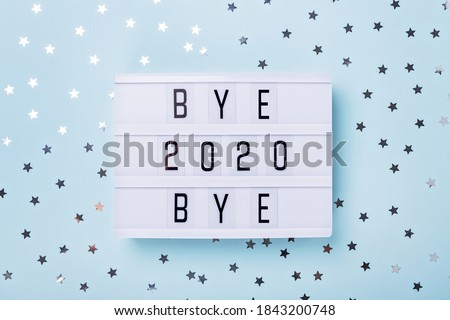 Lightbox with text BYE BYE 2020 on blue background. Top view. New year celebration. Happy New Year 2021 concepts - Image