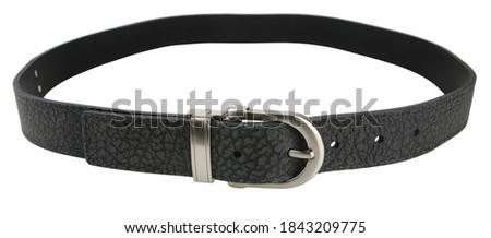 Black leather belt isolated on white background. Royalty-Free Stock Photo #1843209775