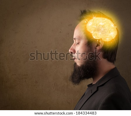 Young man thinking with glowing brain illustration #184334483