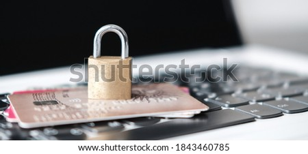 Computer internet credit card security concept with padlock. Credit card data security concept. Data encryption on credit card. The padlock is on Bank cards and laptop. Photo banner