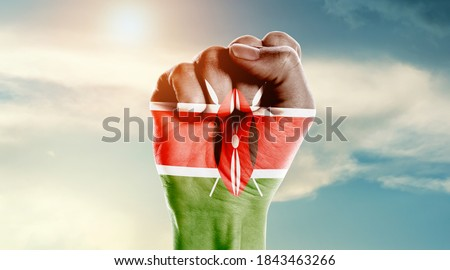 Man hand fist of Kenya flag painted Royalty-Free Stock Photo #1843463266