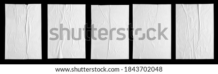 white paper wrinkled poster template , blank glued creased paper sheet mockup.white poster mockup on wall. empty paper mockup. clipping path Royalty-Free Stock Photo #1843702048