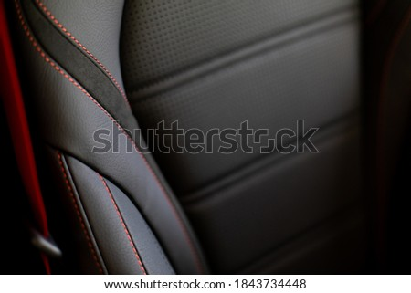 Close up and interior details of modern luxury sport cars. Comfortable leather cockpit seats inside luxury car. Royalty-Free Stock Photo #1843734448