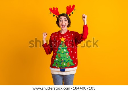 Photo of excited girl in christmas tree sweater pullover deer headband balls raise fists x-mas time noel lottery sale win isolated over bright shine color background #1844007103
