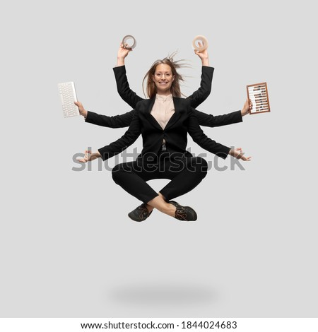 Beautiful business woman, secretary, multi-armed manager levitating isolated on grey studio background. Multi-task worker like Shiva. Concept of business, deadline, balance, time management. Royalty-Free Stock Photo #1844024683