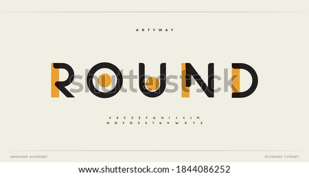 Round modern alphabet. Dropped stunning font, type for futuristic logo, headline, creative lettering and maxi typography. Minimal style letters with yellow spot. Vector typographic design Royalty-Free Stock Photo #1844086252