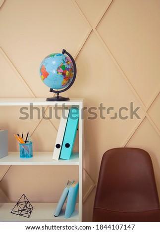 Office interior, globe and plastic file folders