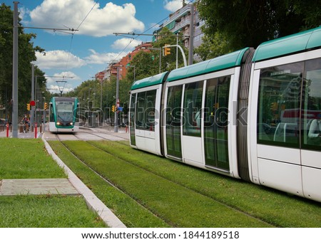 View of the Barcelona tram on Calle Marina. The tram is the most preferred urban transport to the Catalans. Royalty-Free Stock Photo #1844189518